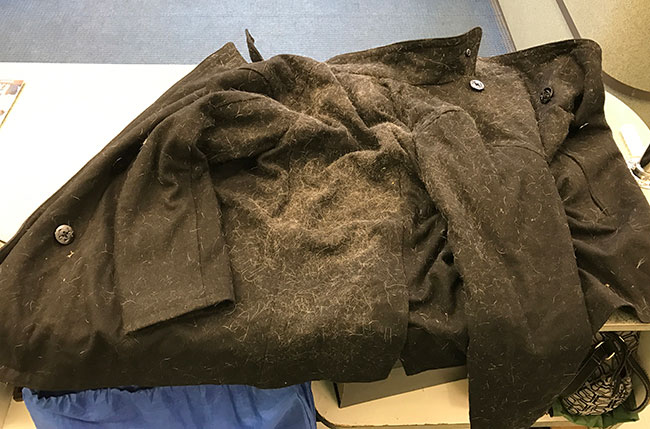 a jacket covered in pet hair