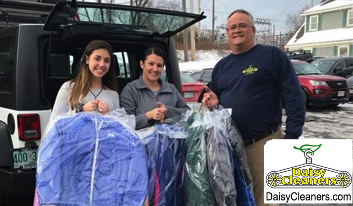 3 daisy staff with a coat donation