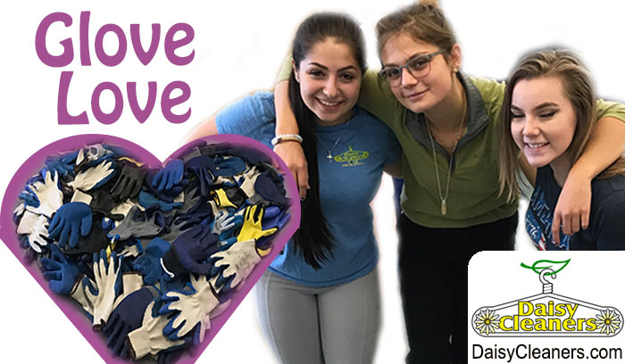 3 women with a pile of gloves in the shape of a heart
