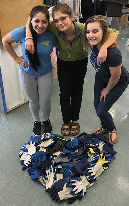 gloves on the floor in the shape of a heart with 3 smiling women
